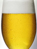 Detail glass of beer. Detail, glass of beer with drops condensation Stock Image