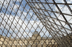 Detail of glass pyramid entrance to the Louvre museum Royalty Free Stock Photography
