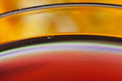 Detail of a glass with red wine and bubbles. Detail close up of a glass with red wine and bubbles royalty free stock images
