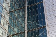 Detail of a glass steel fa�ade of business building in Warsaw. Poland royalty free stock photography