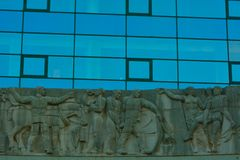 Detail of glass windows and sculpture , the Administrative Centre in the southern city gent Stock Image