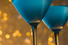 Detail of glasses of blue cocktail on table Stock Photo