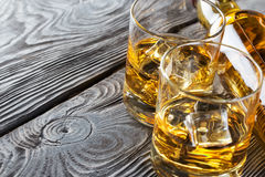 Detail of glasses and a bottle of whiskey Royalty Free Stock Photos
