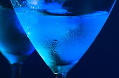 Detail of glasses of fresh blue cocktail with ice on table Stock Photo