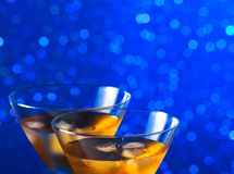 Detail of glasses of  fresh cocktail with ice on bar table Royalty Free Stock Photography