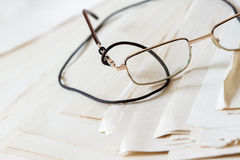 Detail of glasses on old paper. Royalty Free Stock Photos