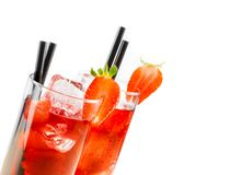 Detail of glasses of strawberry cocktail with ice isolated with strawberry on top Stock Photography