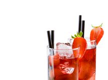 Detail of glasses of strawberry cocktail with ice isolated with strawberry on top Stock Images