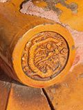 Detail of a glazed object with a dragon, Lama Temple, Beijing, China. Detail of a glazed object with a dragon like image, Lama Temple, Beijing, China Royalty Free Stock Photography