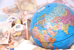 Detail of globe with euro notes around it. Stock Images