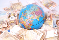 Detail of globe with euro notes around it. Royalty Free Stock Photo