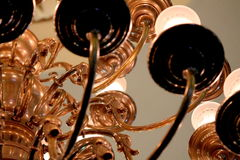 Detail of gold light fixture with ducks stock images