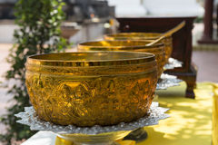 Detail of a golden bowl for Buddhist ceremonies. Chiang Mai, Thailand Royalty Free Stock Photography
