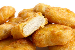 Detail of golden deep-fried battered chicken nuggets with white Stock Photos
