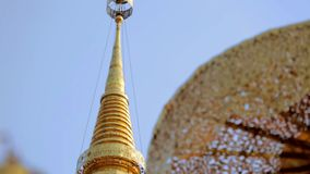 Detail of golden pagoda umbrella temple stock video footage