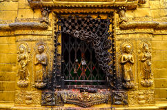 Detail of golden statues in buddhist and hindu temple, Kathmandu Stock Image