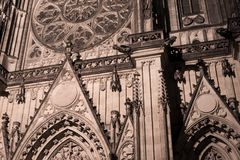 Detail of gothic landmark. Saint Vitus Cathedral, Prague, Czech Republic / Czechia - detail of gothic landmark and monument. Pointed arch and decorated facade Royalty Free Stock Photos