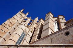 Detail of the gothic medieval cathedral of Palma de Mallorca, S. La Seu, Palma de Mallorca - the cathedral pointing up to the clear blue sky Royalty Free Stock Photo