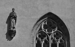 Gothic statue and window in Prague in detail Royalty Free Stock Image