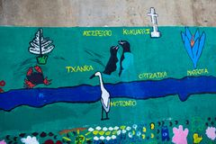 Detail of a graffiti and marine naturalist mural. Detail of a graffiti and marine naturalist mural of green and blue tones with animals and plants of children`s Stock Photo