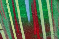 Detail of Graffiti on painted wall. Detail of Graffiti on old painted wall. Done with red, green blue and white color Stock Photos