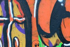 Detail of Graffiti on painted wall. Detail of Graffiti on old painted wall. Done with red, green blue and white color Stock Images