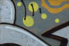 Detail of Graffiti on painted wall. Detail of Graffiti on old painted wall. Grey and yellow colors dominated Royalty Free Stock Image