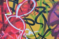 Detail of Graffiti on painted wall. Detail of Graffiti on old painted wall. Redand yellow colors dominated royalty free stock photos