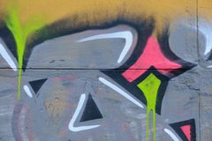 Detail of Graffiti on painted wall. Detail of Graffiti on the wall, yellow, pink, grey and black Royalty Free Stock Photo