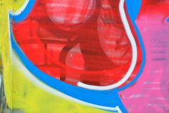 Detail of Graffiti on painted wall. Detail of Graffiti on the wall, yellow, red and blue Royalty Free Stock Photos