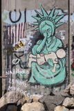 Detail of graffiti on the separation barrier between Palestine and Israel. BETHLEHEM, PALESTINE - OCTOBER 7, 2016: Detail of graffiti on the separation barrier Royalty Free Stock Photography