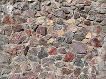 Granite wall. Detail of a granite wall, nice texture or background Royalty Free Stock Photos