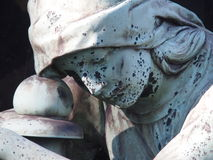 Detail of a gravestone. Showing the face of a sorrow woman Stock Photography