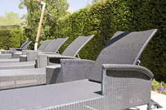 Detail of gray chairs at a Luxury resort swimming Stock Photos