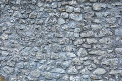 Stone wall texture. Detail of a gray stone wall - stone wall texture Stock Image