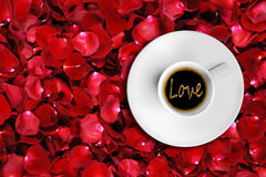 Detail of great italian espresso coffee in a white cup, top of view with foam love word shape Stock Images
