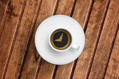 Detail of great italian espresso coffee in a white cup on wood table, time to breakfast Stock Images