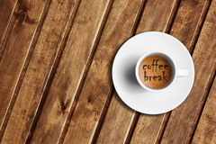 Detail of great italian espresso coffee in a white cup on wood table, time to coffee break Stock Image