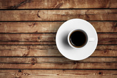 Detail of great italian espresso coffee in a white cup on wood table Royalty Free Stock Photography