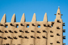 Detail of the Great Mosque of Djenne, Mali. The Great Mosque of Djenné is the largest mud brick or adobe building in the world and is considered to be the Royalty Free Stock Images