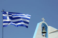 Detail of a greek church with flag Stock Images
