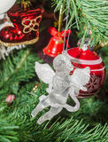 Detail of green Christmas (Chrismas) tree with colored ornaments, globes, stars, Santa Claus, Snowman. Red boots, shoes, candles, bells, white transparent Royalty Free Stock Image