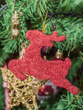 Detail of green Christmas (Chrismas) tree with colored ornaments Stock Image