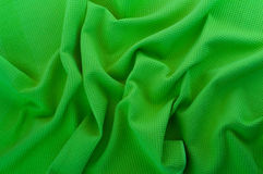 Detail of green mint tissue. Crumpled blue fabric texture closeup Royalty Free Stock Photography
