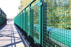 Detail of green railing at empty bridge. Photo of detail of green railing at empty bridge stock photos