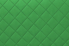Detail of green sewn leather, green leather upholstery background pattern Royalty Free Stock Photos