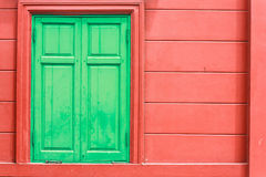 Detail of green window on red wall. Of old house Royalty Free Stock Photography