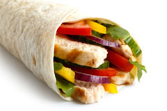 Detail of grilled chicken and salad tortilla wrap on white backg Royalty Free Stock Photography