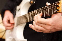Detail of guitarist hands. Royalty Free Stock Photo