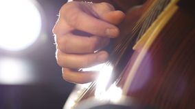 Detail of a guitarist playing classical guitar stock footage